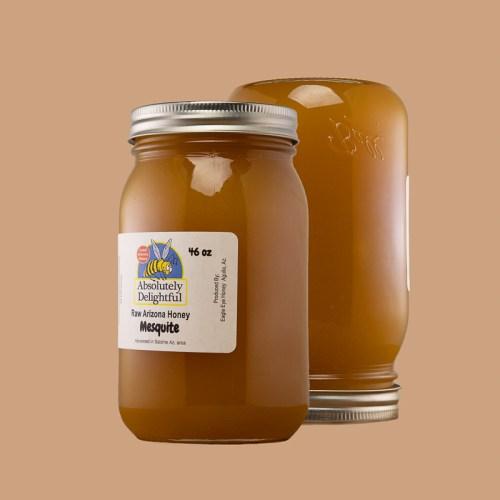 Large Jars of Crystallizing Mesquite Honey Floating