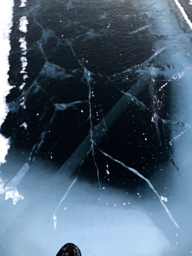 Deep and shallow cracks in the ice road to Dettah on Great Slave Lake