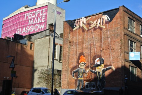 Mural and the latest strapline used to market Glasgow (What cities are not made by people?)