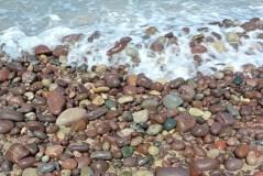 Pebbles and sea on Sandwood Bay