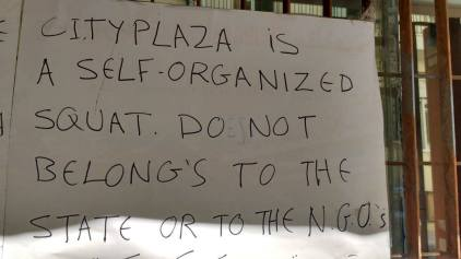 Notice on a squat for refugees in Athens