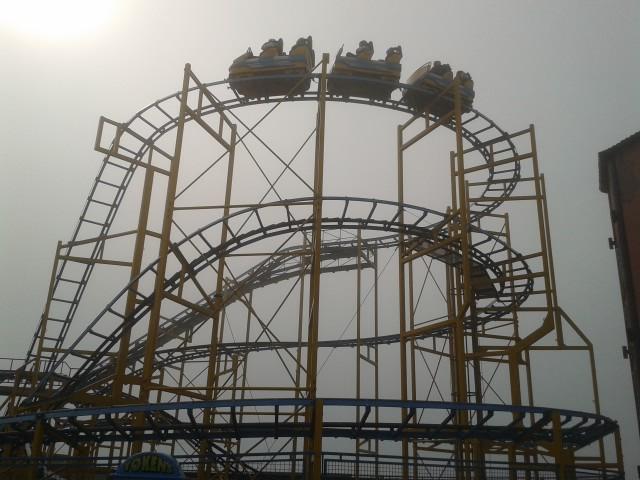 Brighton Pier fairrgound ride in the fog with a weak sun