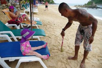 Getting VIP treatment at Nai Harn Beach, Phuket