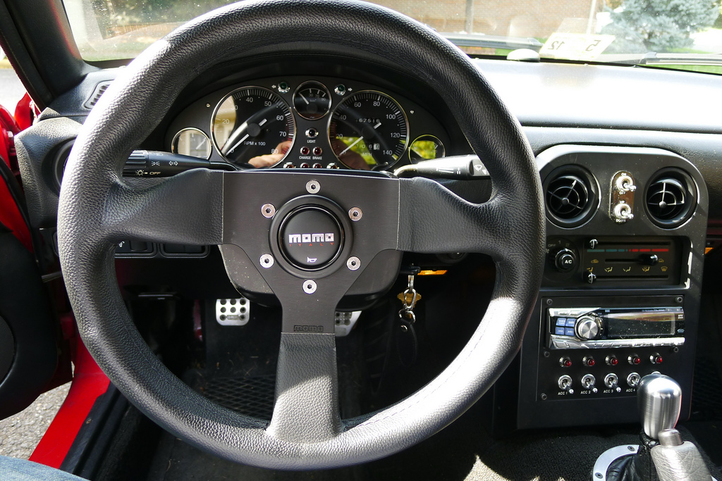 MOMO Montecarlo 320mm steering wheel and custom Revlimtier M2-1028 gauges in mph