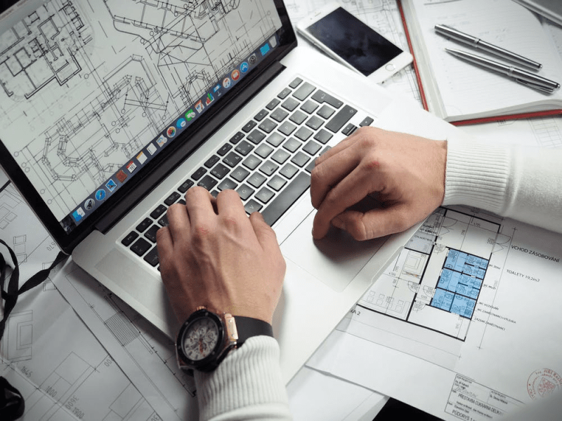 Person working on digital architectural drawings
