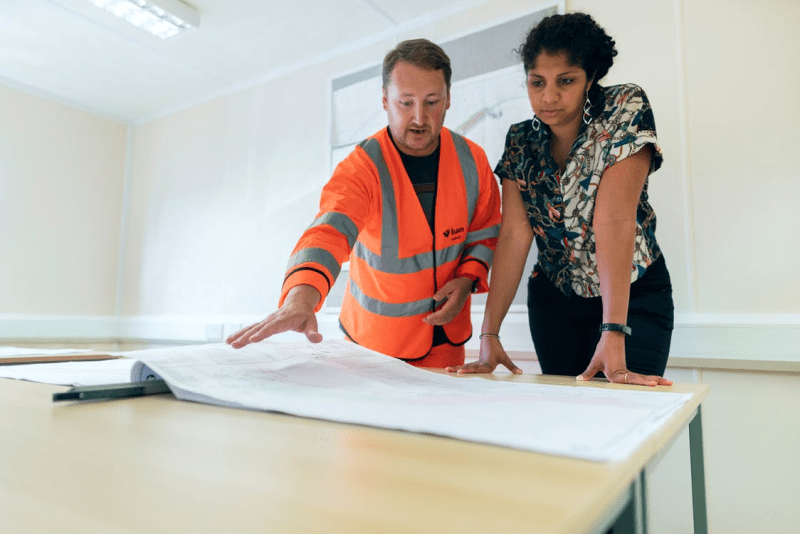 Project manager discussing drawings with client