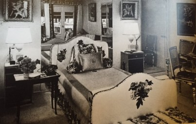 her LA bed with mirrored wall and découpage chintz