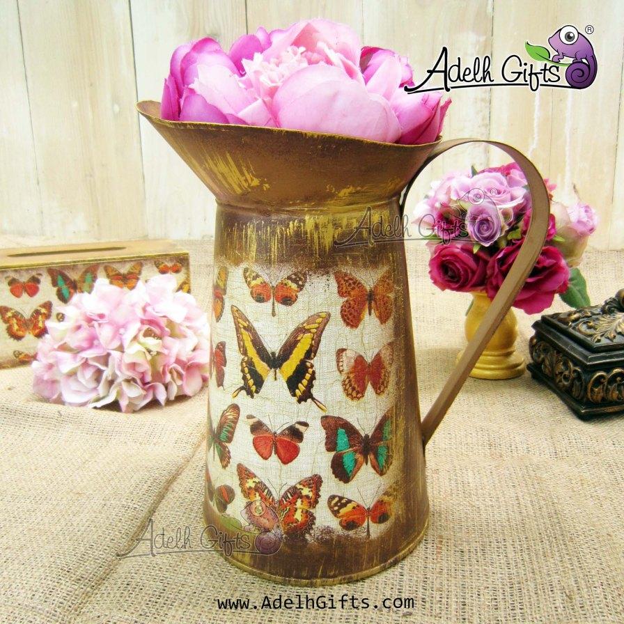 kaleng siraman butterfly