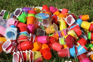 colorful plastic cups and one glass jar
