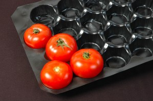 black plastic packaging tomatoes