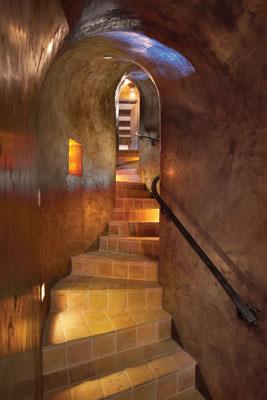 basement curved stair rail adg lighting