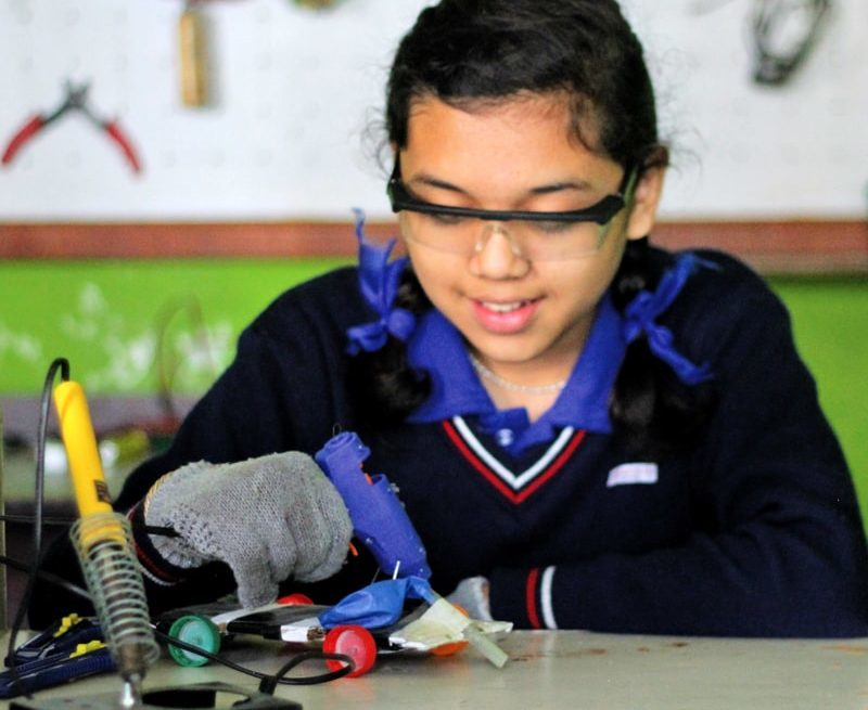 Student engaging in creative activity