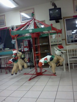 A very creepy and very out of season display at one extremely creepy laundromat.