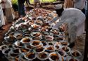 A Muslim arranging Iftar, the food taken after fasting, for the students of a madrasa in Chittagong, during the month of Ramadan. Bangladesh.