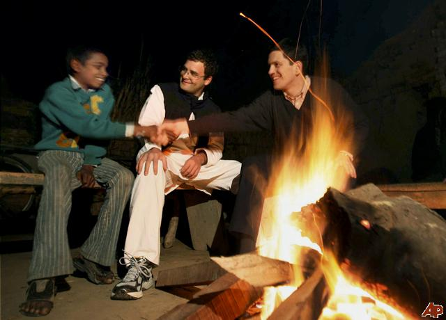 """DoBritish Foreign Secretary David Miliband, right, shakes hands with a village boy, as Indian lawmaker Rahul Gandhi looks on in Semra village, India, Wednesday, Jan. 14, 2009. Miliband spent a night in the house of a Dalit family, the group once known in India as """"untouchables,"""" at the invitation of Gandhi, according to news reports. ( we see a modern Mahatma in Making."""