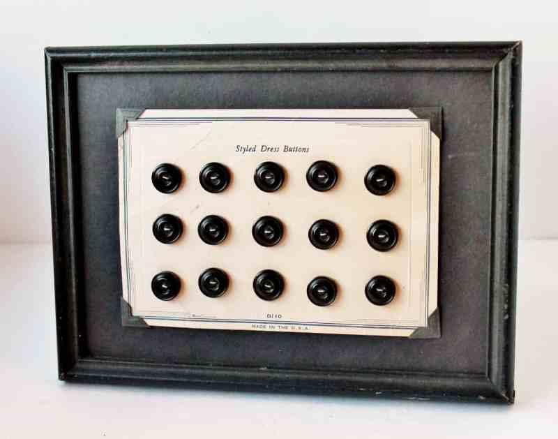 framed card of vintage plastic buttons