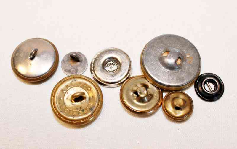various backs of vintage metal buttons