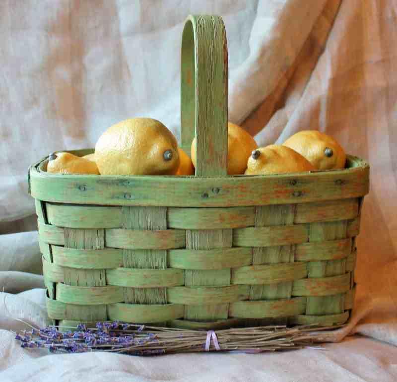 green basket with lemons and lavendar