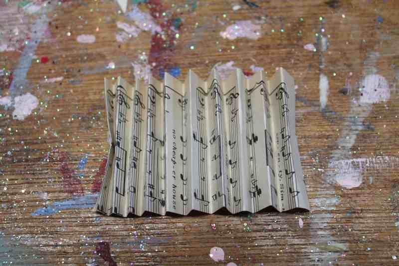 Folding vintage music paper like a fan