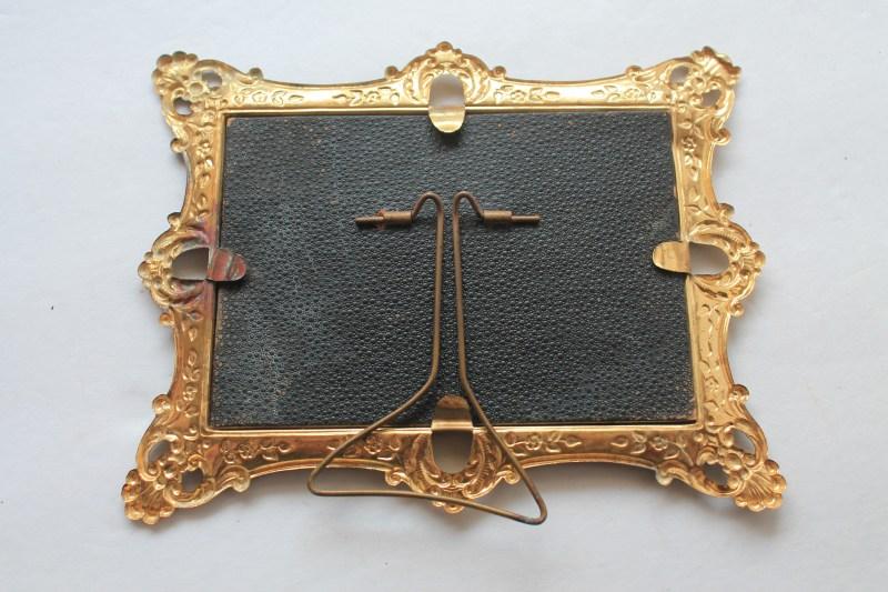 Back of Vintage Gold Metal Frame
