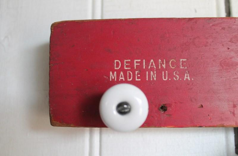 Close up of white ceramic knob on red level
