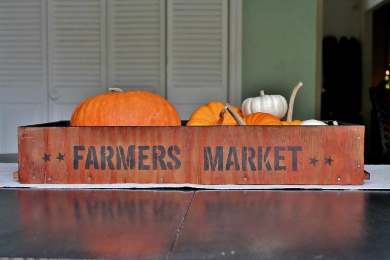 vintage farmer's market tray with pumpkins