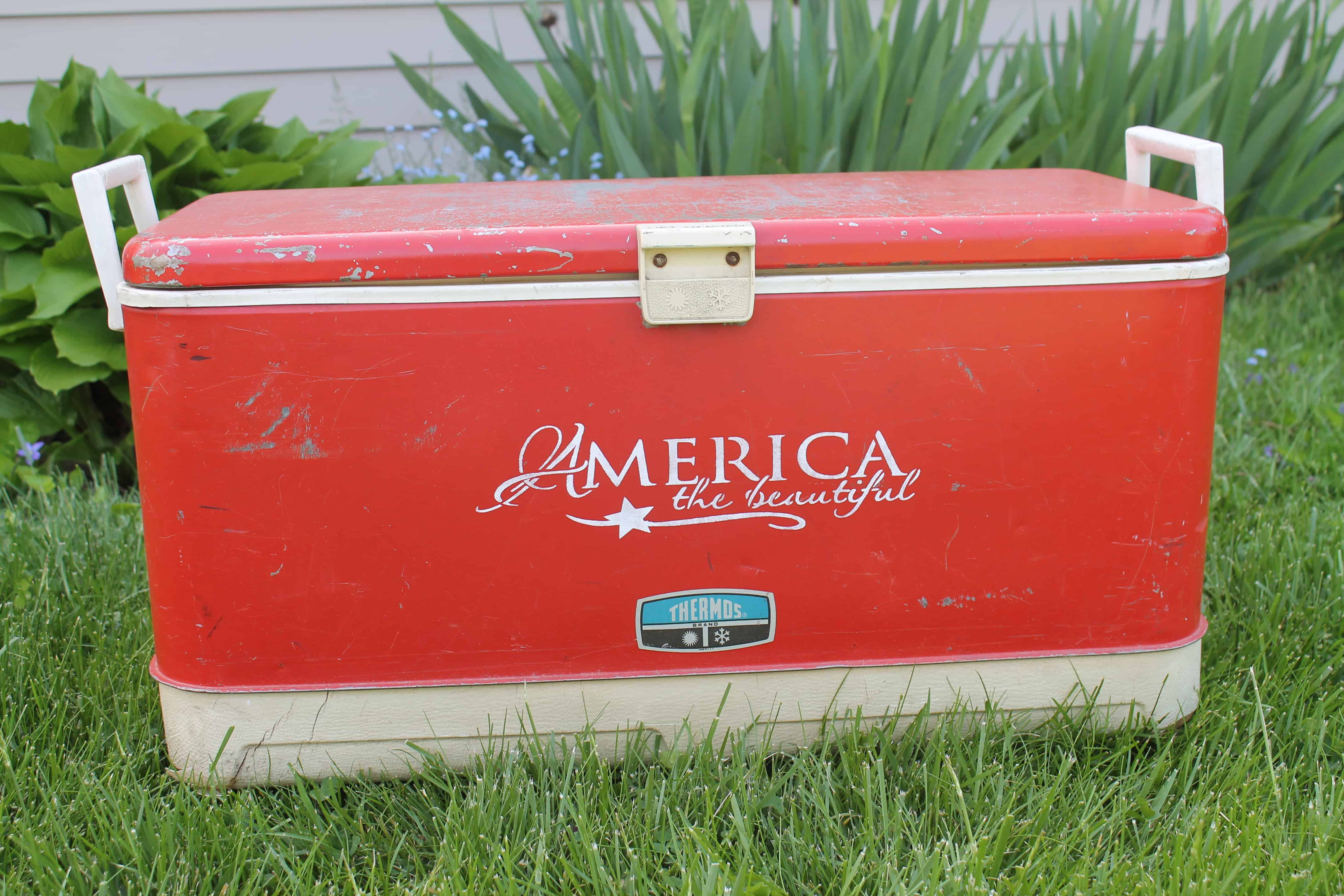Vintage red cooler with America stencil