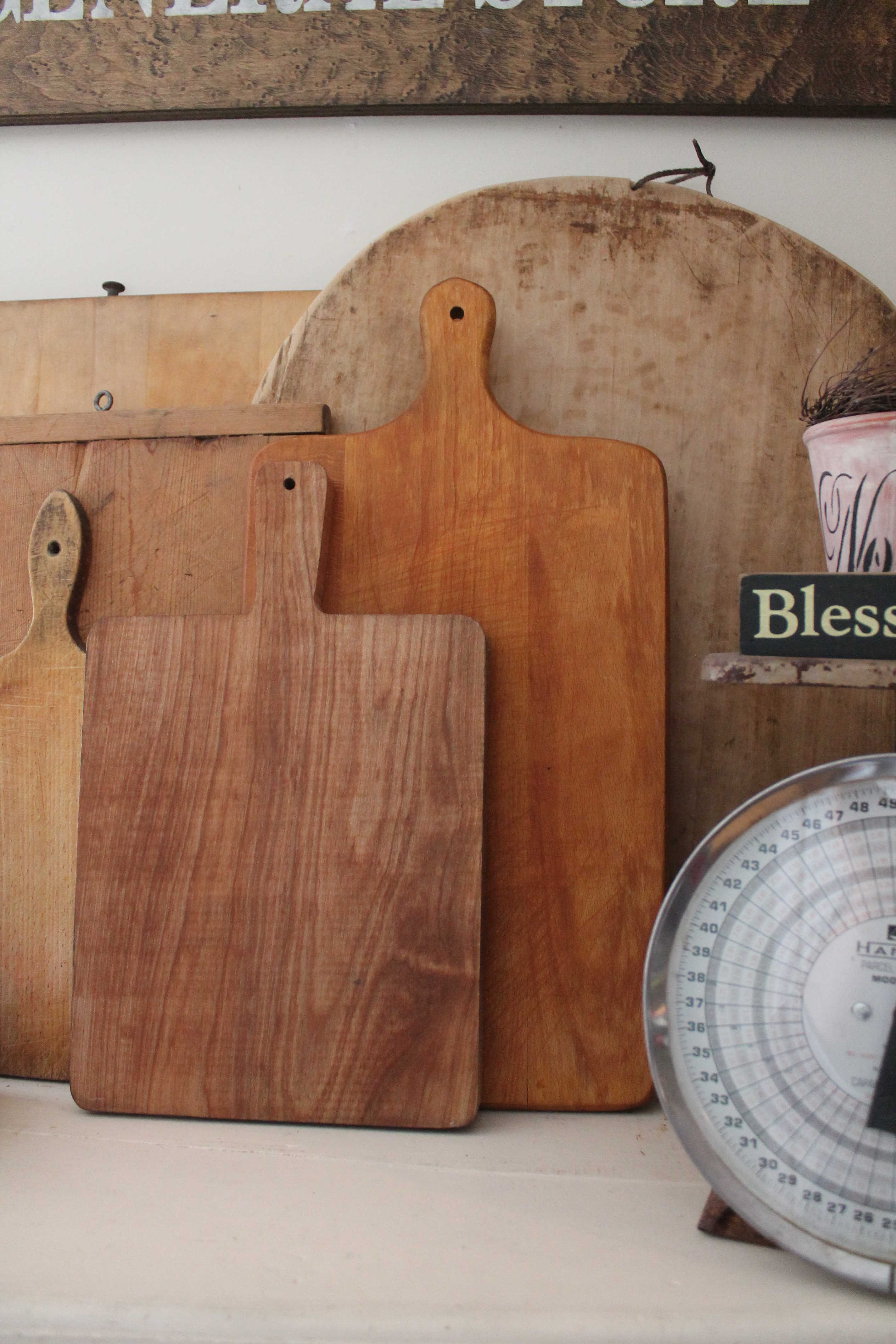 Collection of vintage cutting boards on display