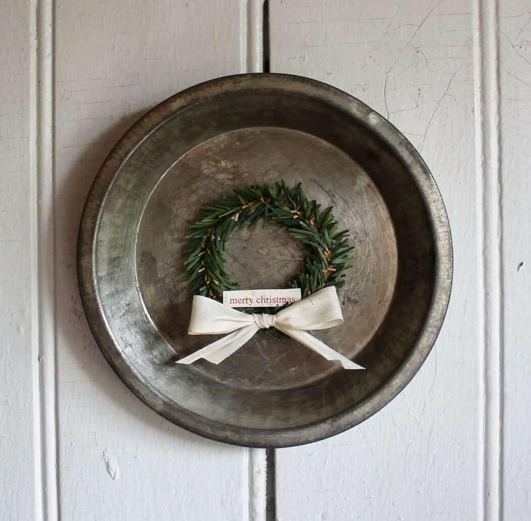 A vintage tart pan with mini wreath decoration