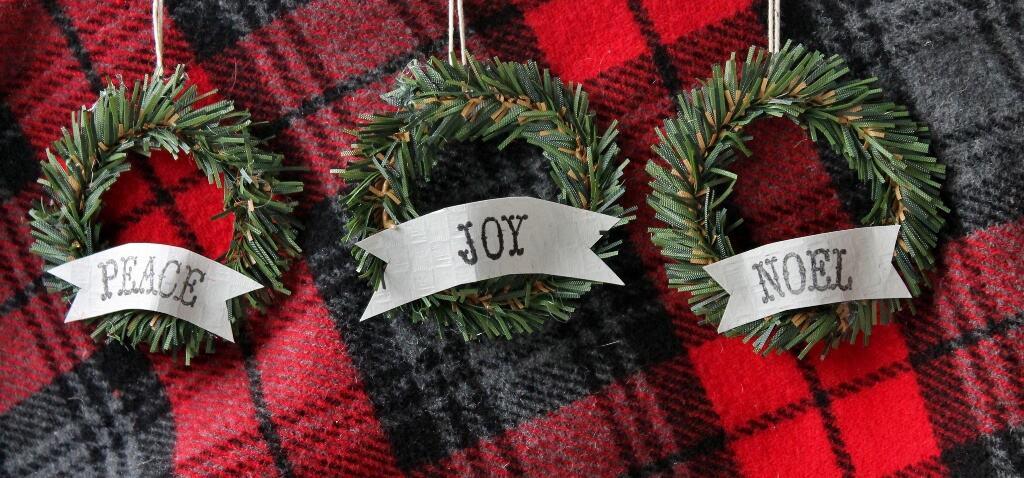 Three Vintage Y Mini Wreaths Displayed On Red And Black Plaid Wool Fabric Background