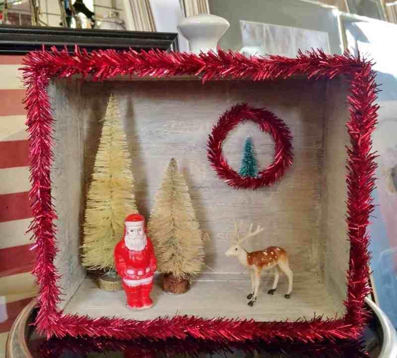 Vintage cigar box diorama with santa and a deer