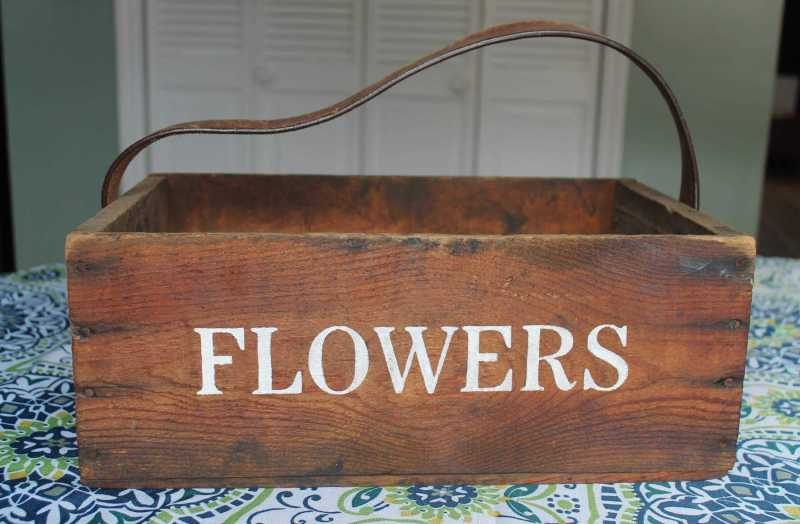 vintage flower crate with leather strap