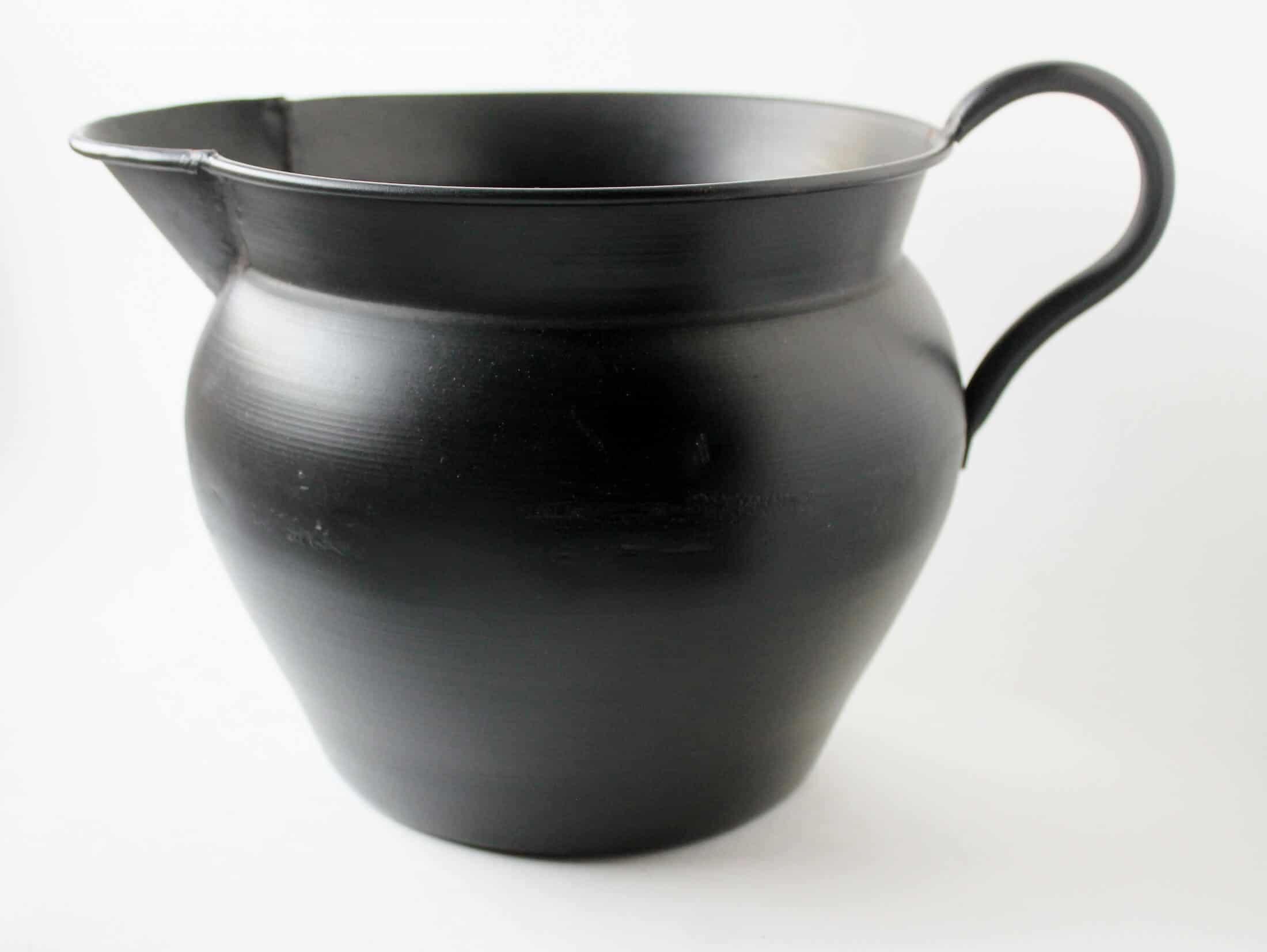 vintage black metal pitcher