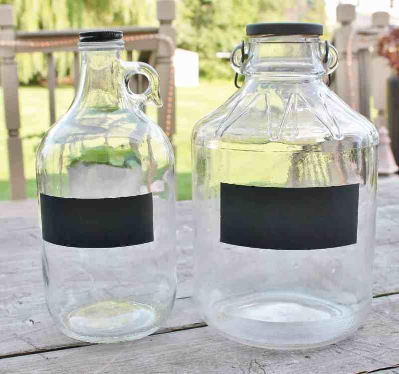 jugs with chalkboard labels