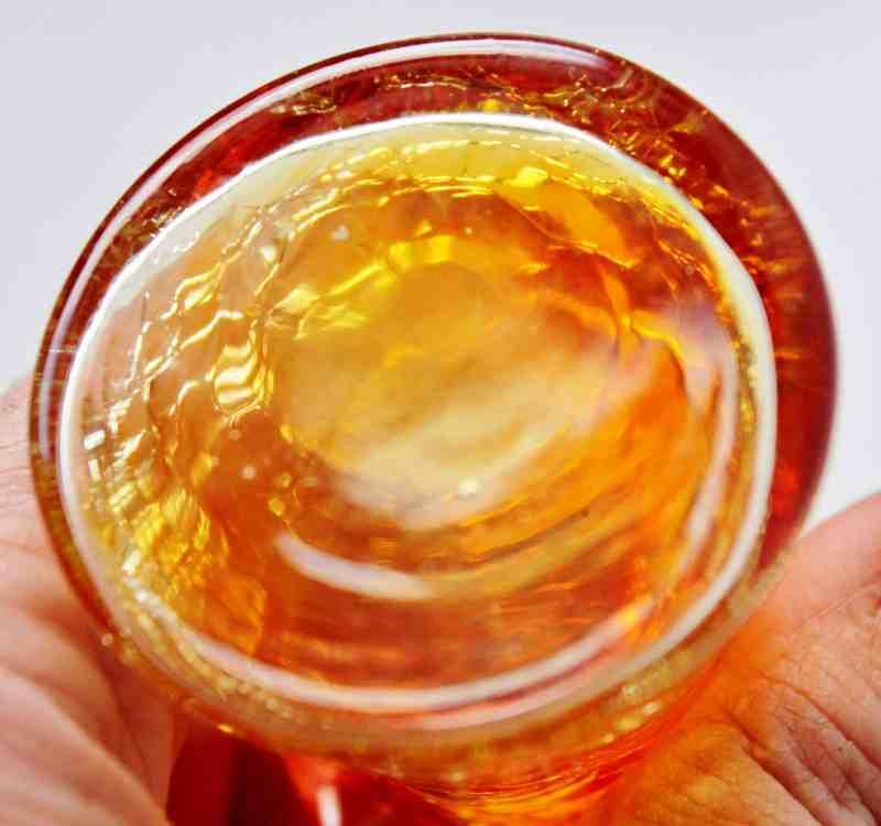 bottom of vintage crackle glass amberina vase
