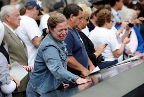 epa02909617 A woman cries while looking at the names inscribed at the North Pool of the 9/11 Memorial during tenth anniversary ceremonies at the site of the World Trade Center September 11, 2011, in New York, USA. EPA/JUSTIN LANE / POOL