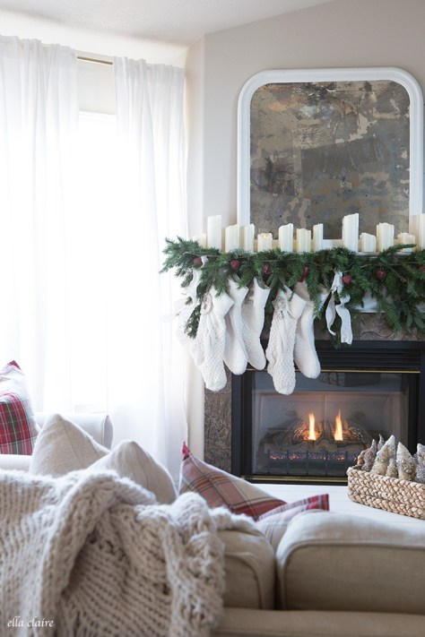 Fireplace Decor with Garland and Ivory Stockings
