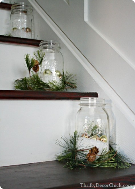 Staircase Decorated With Ball jars Filled with Fake Snow and Ornaments