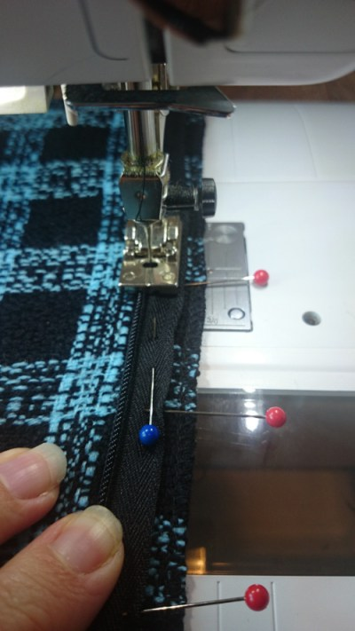Sewing the zip after carefully pinning