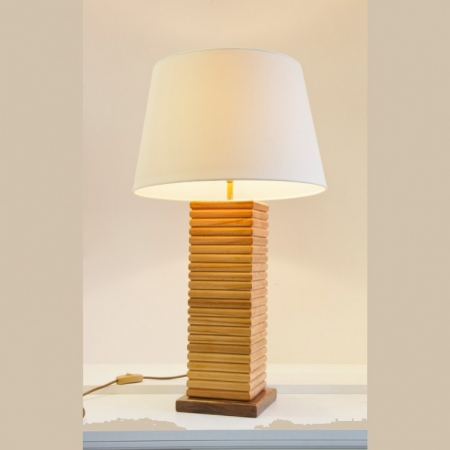 This Beech lamp is handcrafted from individual pieces of beech layered in a vertical style to give the towered effect. This lamp has simple lines, displaying the contrasting differences between side grain and end grain of timbers. This lamp is ideal for modern spaces thanks to it geometric shape and style. The striking shape and style of this lamp make it the ideal gift for Christmas, Weddings and Corporate occasions. (Shade is not included).