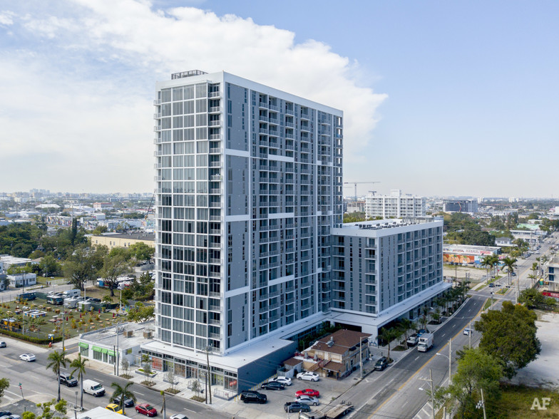 Midtown Miami apartment building aerial view with road and city views.