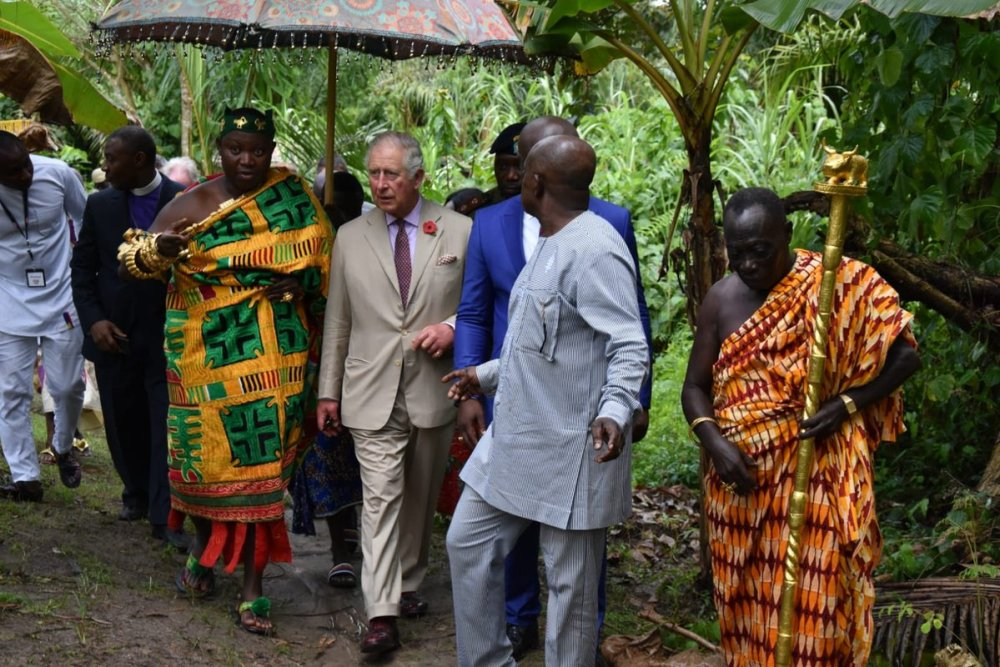 Accompanied by the farm owner, Mr. Agyin Brefo, His Royal Highness takes a tour of the farm to see production and post-production of cocoa.