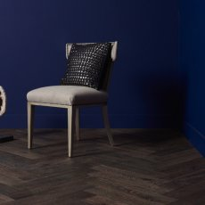 Grosseto flooring, chair and prop, right corner blue wall