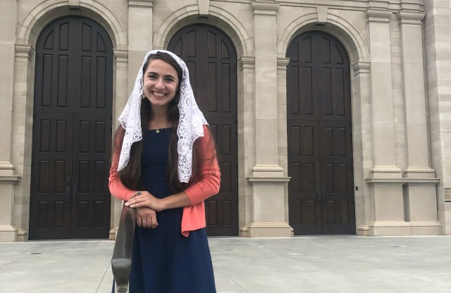 Elizabeth Sisk stands in front of Holy Name of Jesus Cathedral in Raleigh, North Carolina.