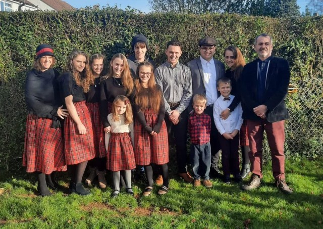 Emma and Andy Stevens with their 12 children in Oxford, England.