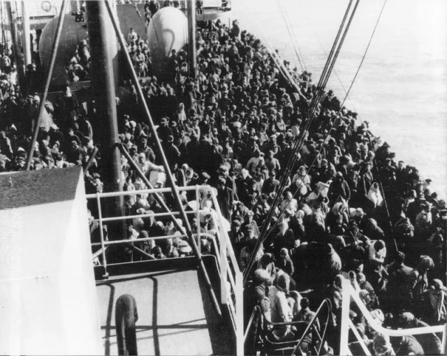 The USS Meredith piled with 14,005 refugees. / Public Domain.