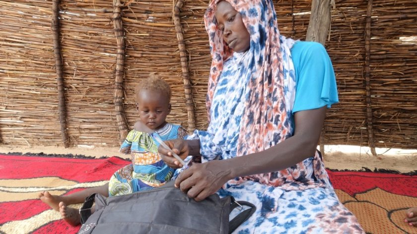 Khamissa Ibrahim is 32 years old. She has six children: Fatouma (9), Ahmad (7), Zakia (5), Aisha (4), Umaima (3) and Rafaida (1 and a half) – pictured – and is six months pregnant. Khamissa is a Concern-trained Community Health Volunteer. She also sells onions, salt, garlic, oil, okra and chili. Before Concern, she worked in the fields to support her family during the lean period. Khamissa is independent and runs her own business. She stores millet, peanut and sesame and from these stores, she loans stock t