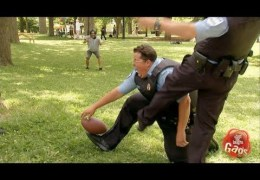 Cop plays football and get kicked