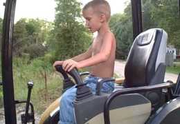 6 Year Old Operating mini Excavator