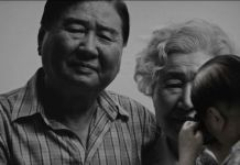 2 The Last Wish_an old man shedding tears in front of his family photo at the exhibition 563.jpg